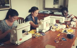 CAST Kruger sewing masks food parcels